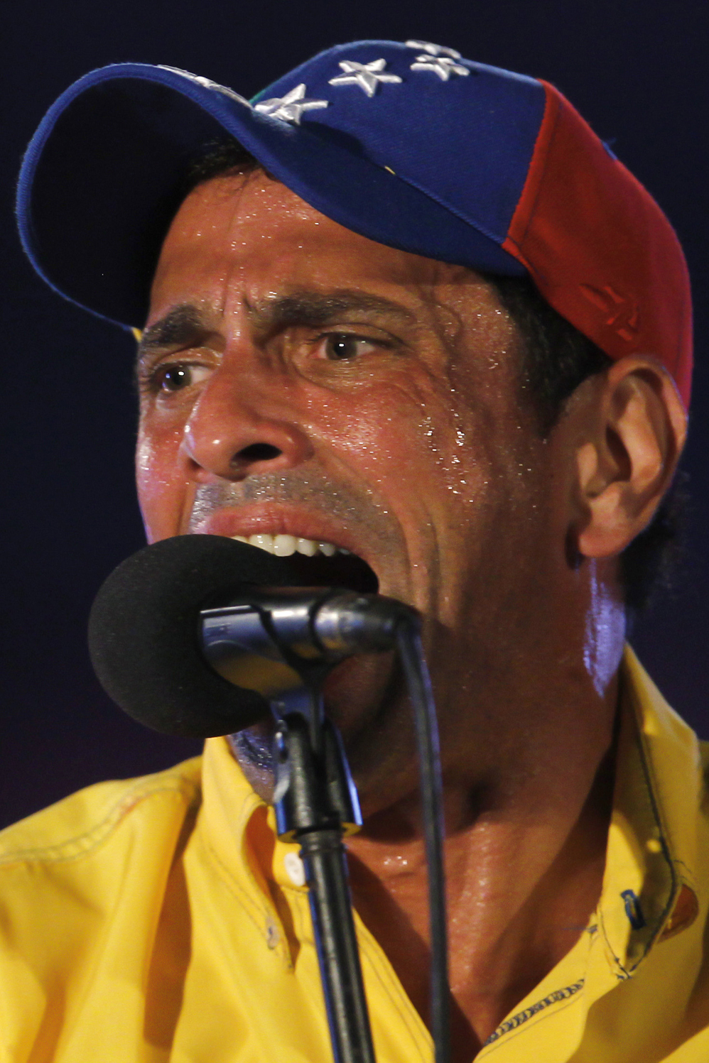 Venezuela's opposition leader and presidential candidate Capriles speaks to supporters during a campaign rally in the state of Lara