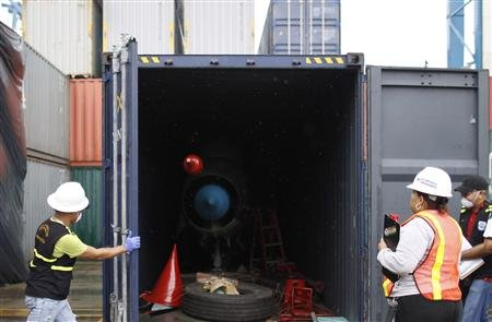 container holding a MiG-21 figther jet