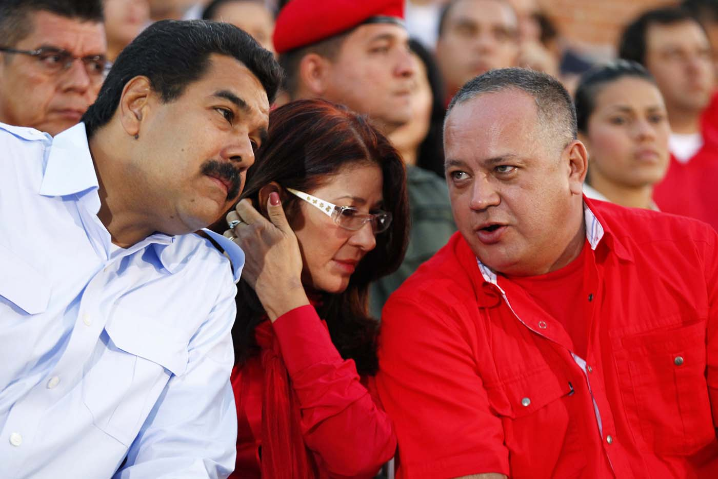 Venezuela's President Nicolas Maduro sits next to his wife Cilia Flores as he talks to National Assembly President Diosdado Cabello in Caracas