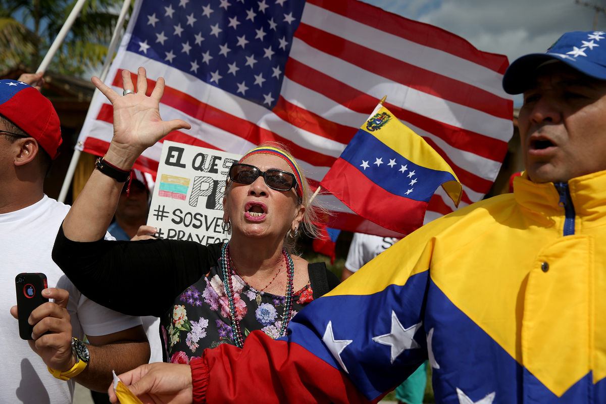 Expats in Miami show their support for anti-government protests in Venezuela in March 2014